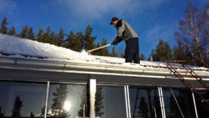 cleaning snow from a roof